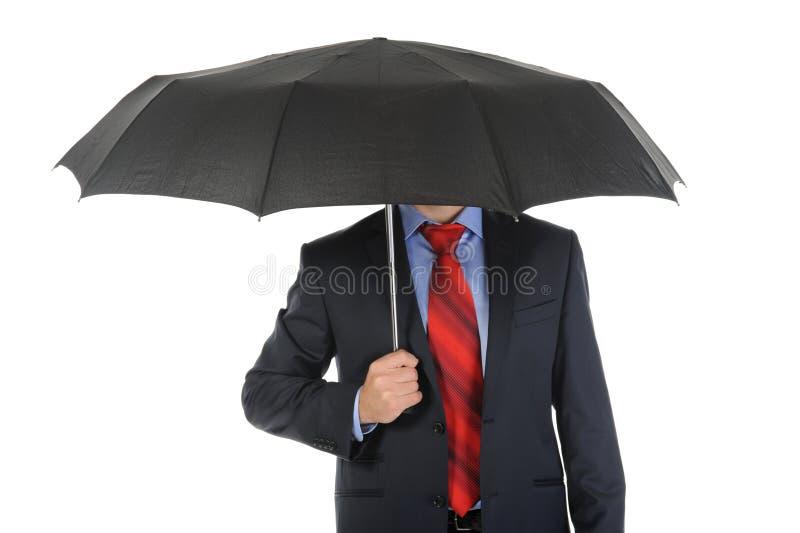 Imagen de un hombre de negocios con el paraguas foto de archivo