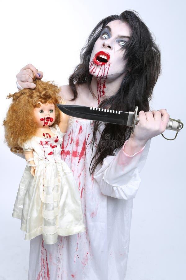 Imagen de una mujer del psicópata de la sangría imagenes de archivo