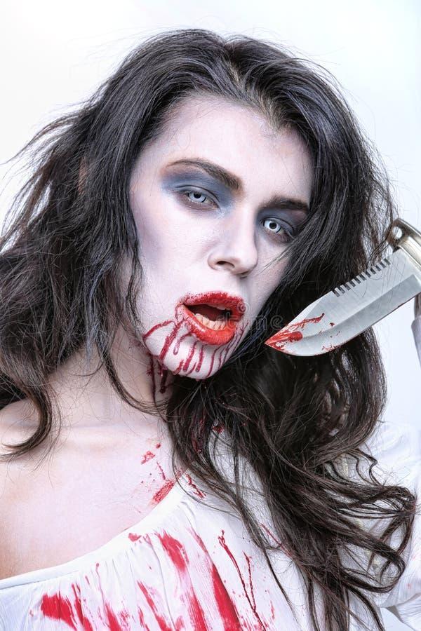 Imagen de una mujer del psicópata de la sangría fotografía de archivo libre de regalías
