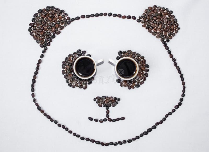 Imagen de una panda hecha de los granos de café fotografía de archivo libre de regalías