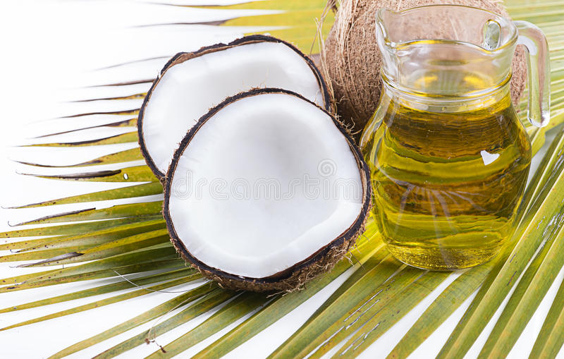 Imagen del aceite de coco para la terapia alternativa fotos de archivo