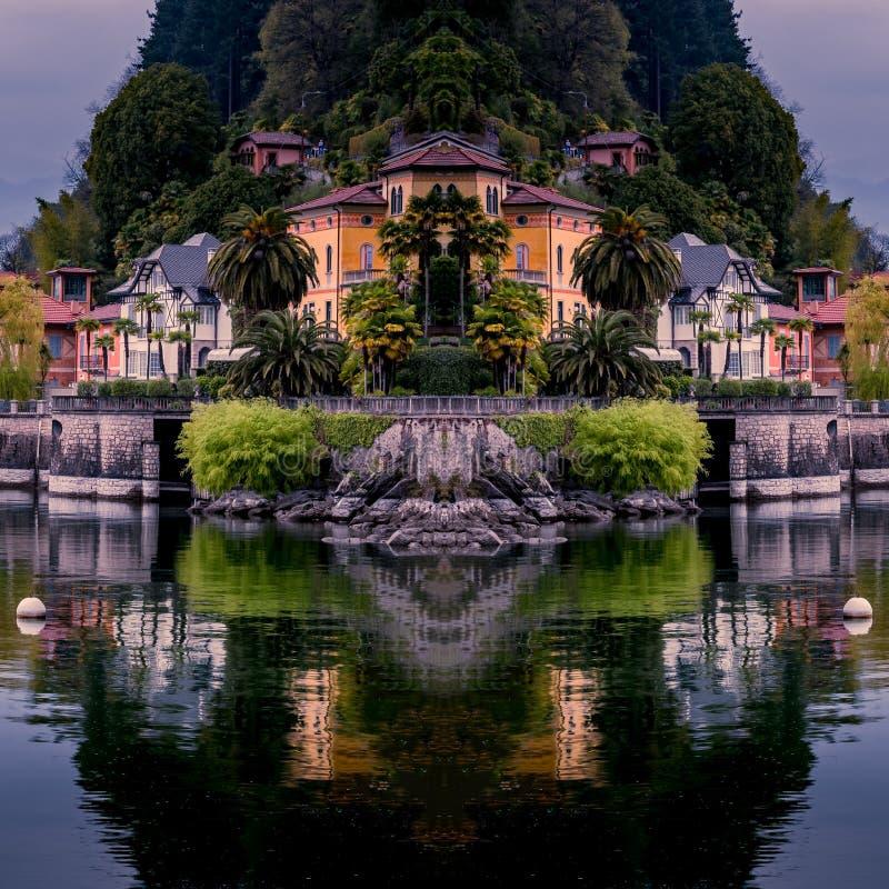 Imagen del cannero riviera en el maggiore del lago con el barco de navegaci?n amarillo y de edificios en el frente del lago fotos de archivo libres de regalías
