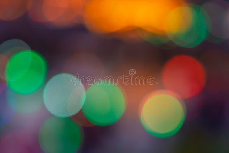 imagen del fondo borroso del bokeh con las luces coloridas calientes Tono del vintage imagen de archivo libre de regalías