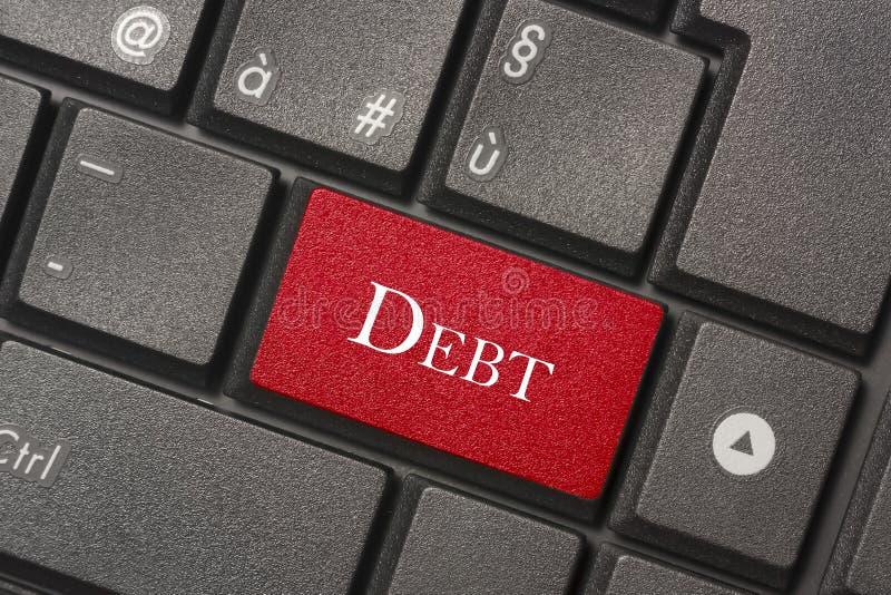 Imagen del primer del botón de la deuda de un teclado moderno foto de archivo libre de regalías