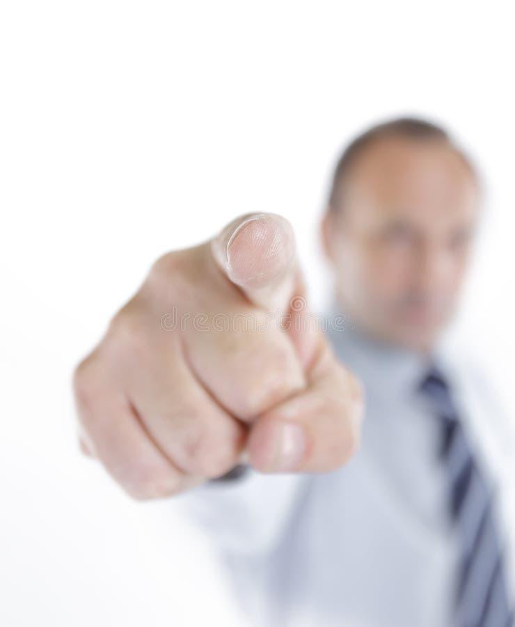 Imagen enmascarada Hombre de negocios que señala su dedo en usted imagen de archivo libre de regalías