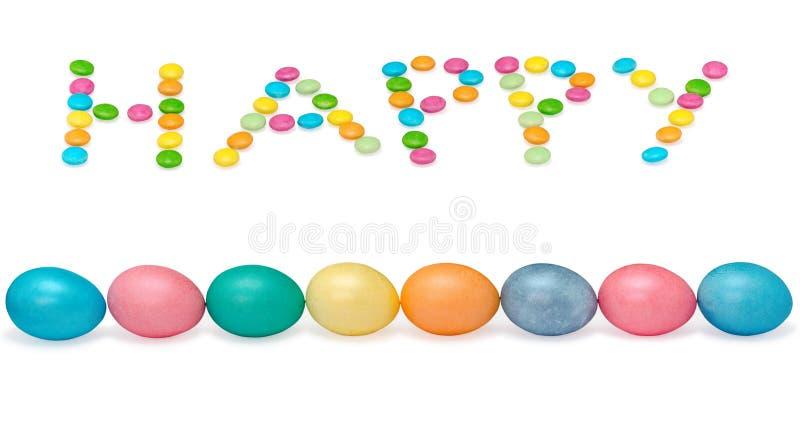 Imagen feliz de pascua con ocho huevos y candys imagen de archivo libre de regalías