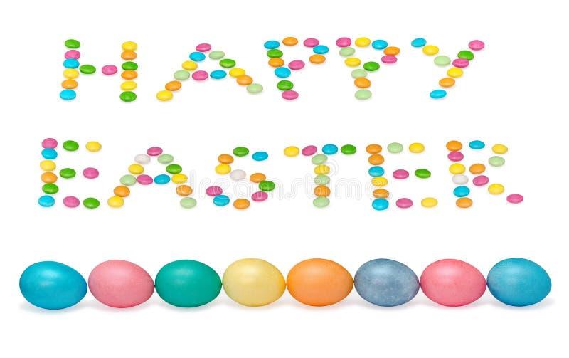 Imagen feliz de pascua con ocho huevos y candys imágenes de archivo libres de regalías