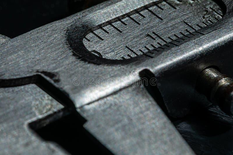 Imagen macra del calibrador de un carpintero imágenes de archivo libres de regalías