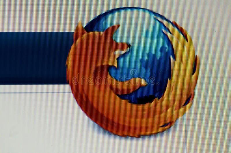 Imagen macra del monitor con insignia del firefox del mozila foto de archivo