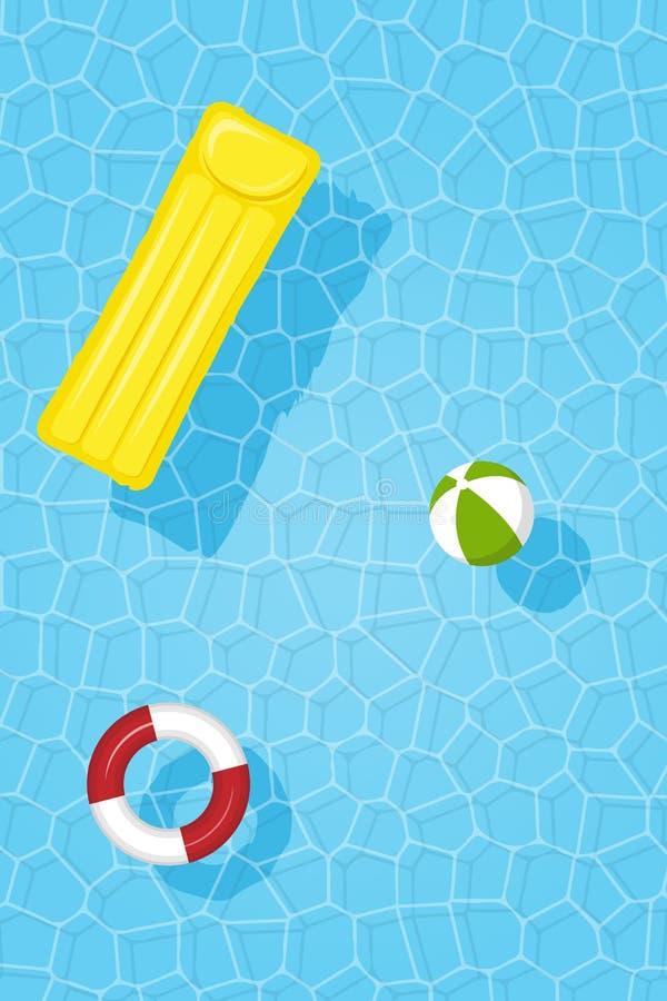 Imagen vertical del agua de la piscina con el círculo, el colchón y la bola inflables foto de archivo libre de regalías