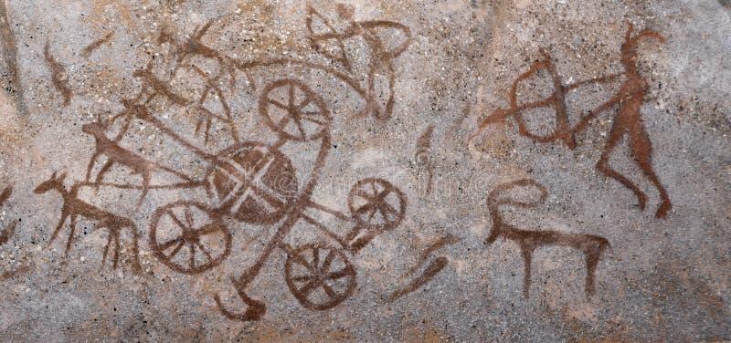 Imagens antigas na parede do ocre da caverna ilustração royalty free