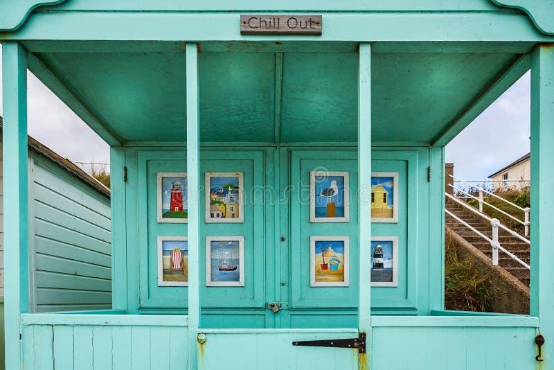 Imagens de cenas do beira-mar em portas da cabana da praia em Southwold, Suffolk, Reino Unido imagem de stock royalty free