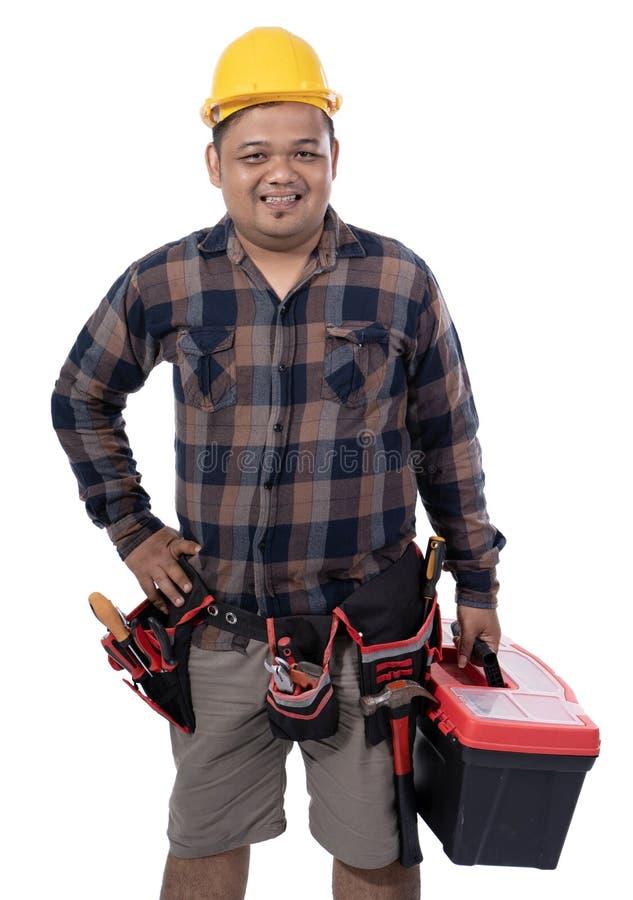 Imagens de um mecânico novo com capacete e das mãos na cintura imagens de stock