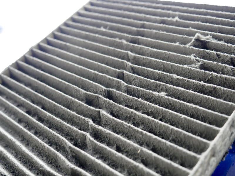 Imagens do close-up de filtros sujos do condicionamento de ar dos carros fotografia de stock