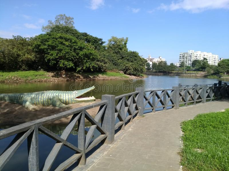Images of outdoor park with river and trees stock photo