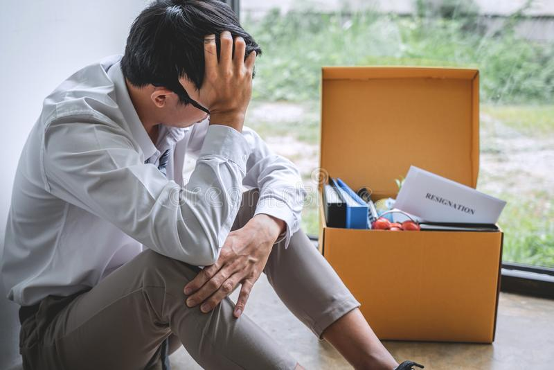 Images of packing up all his personal belongings and files into a brown cardboard box, Businessman has frustrated and stressed to stock images
