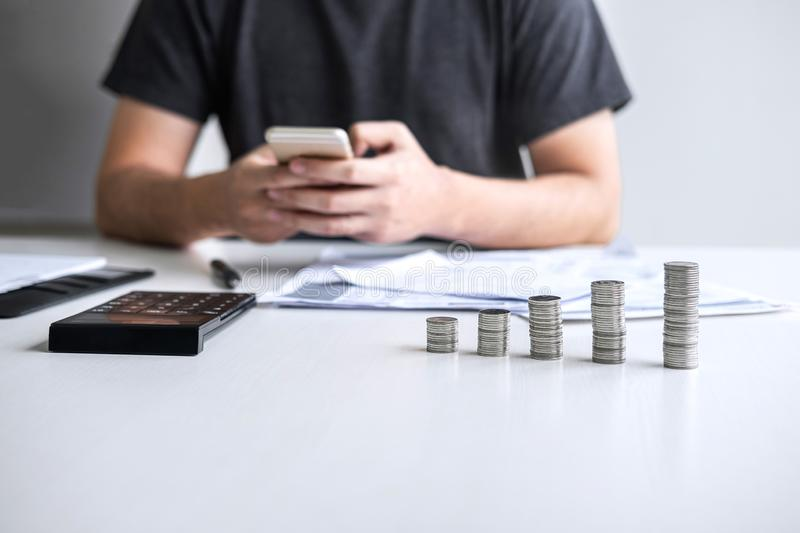 Images of stacking coin pile and Husband using smartphone to calculating expenditure receipt bills of various activity cost and stock images