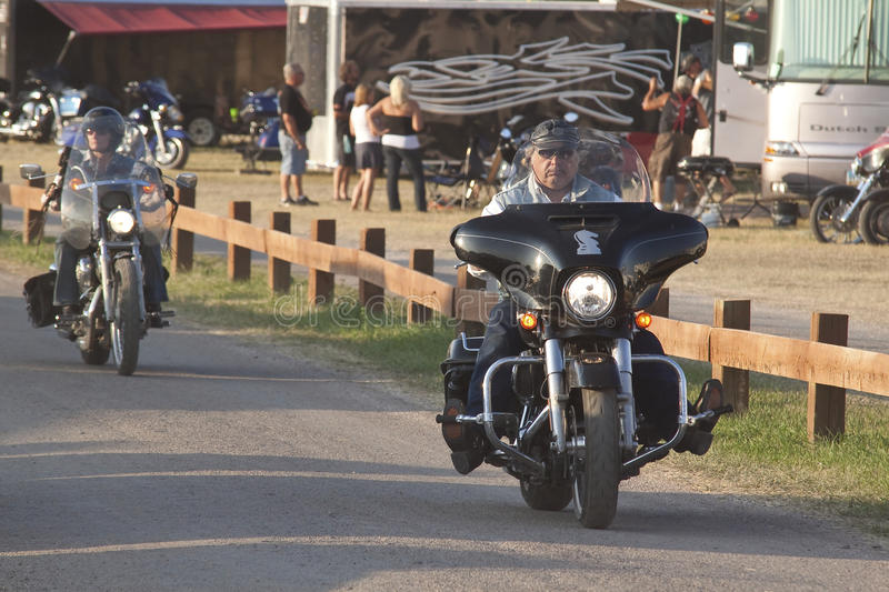 Images of sturgis rally south dakota. Bikers along the road during the annual sturgis bike rally,the rally is the first week of august all around the black hills royalty free stock images