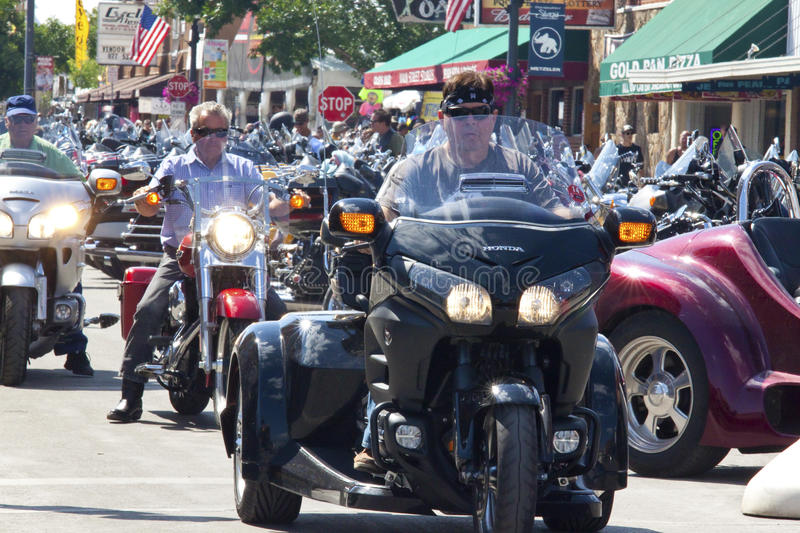 Images of sturgis rally south dakota. Bikers along the road during the annual sturgis bike rally,the rally is the first week of august all around the black hills royalty free stock photos