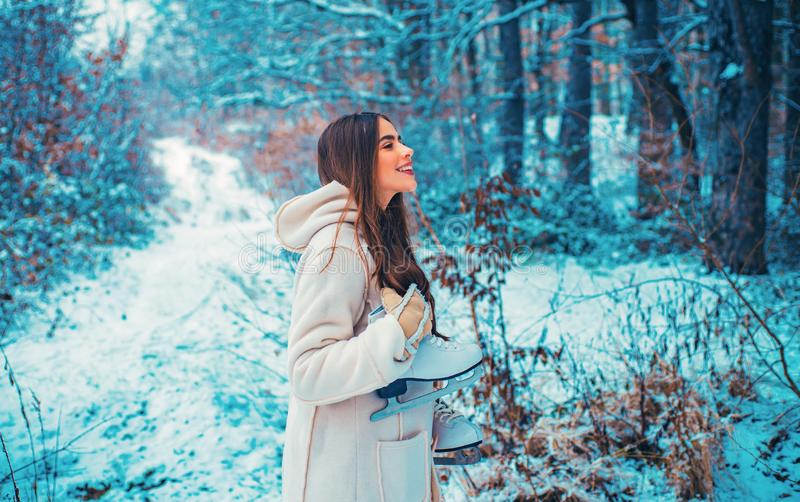 Images for winter. Winter woman clothes. Season of Winter. Models having fun in winter park. stock photography