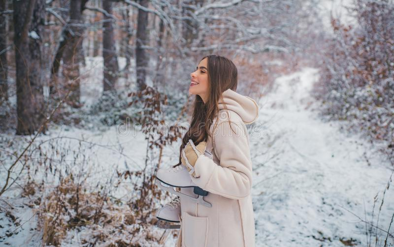 Images for winter. Winter woman clothes. Season of Winter. Models having fun in winter park. stock images