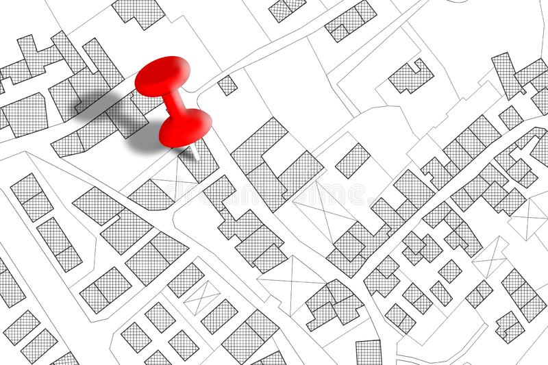 Imaginär matrikel- översikt av territoriet med byggnader, vägar och landjordlotten - begreppsbild med en röd häftstift på den stock illustrationer