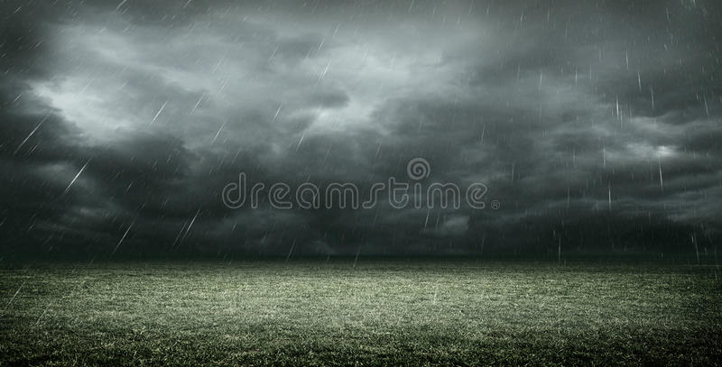 The Imaginary Soccer Stadium with dark clouds and rain, 3d rendering. The imaginary soccer stadium is modelled and rendered stock illustration