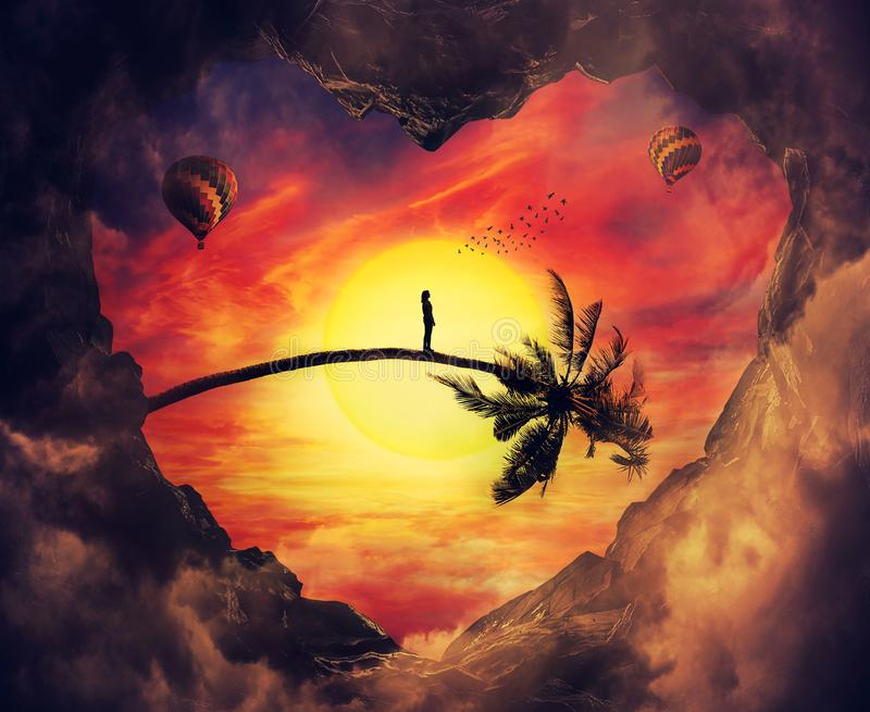 Heart sunset. Imaginary view from a heart shaped cave to a exotic sunset sky and a lonely girl waiting on a bent palm tree trunk looking to a hot air balloon at stock images