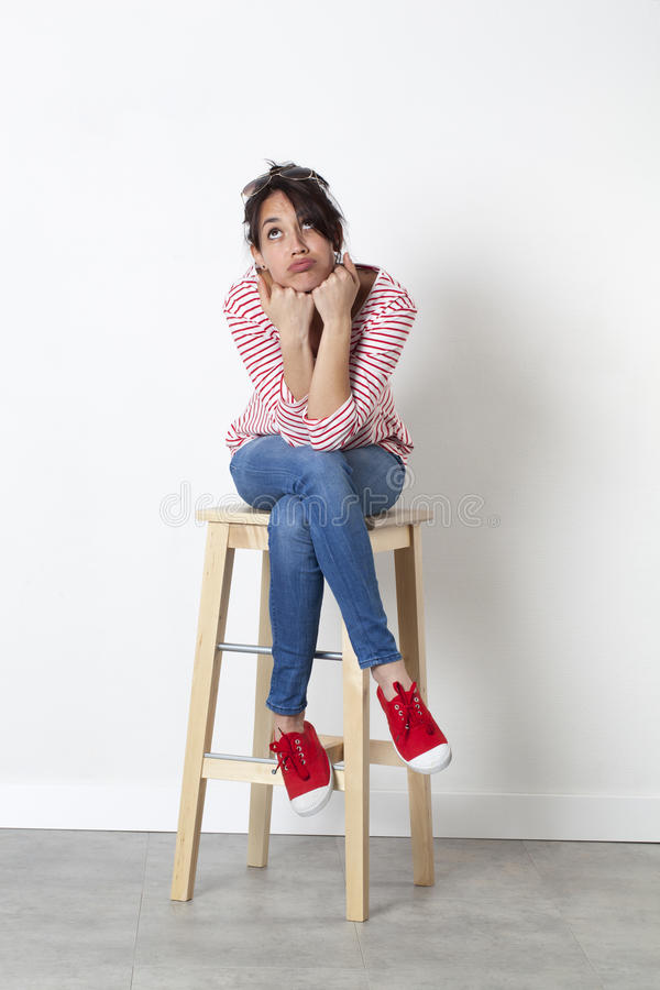 Imagination concept for pouting 20s multi-ethnic woman royalty free stock image