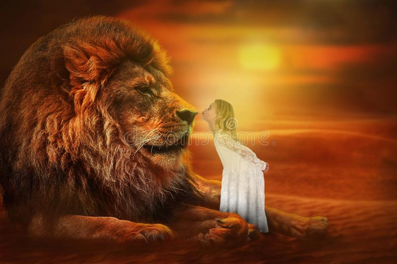 Imagination, Girl Kiss Lion, Love, Nature. Abstract concept for imagination, love, and nature. A young girl steals a fantasy kiss from a male wildlife lion royalty free stock images