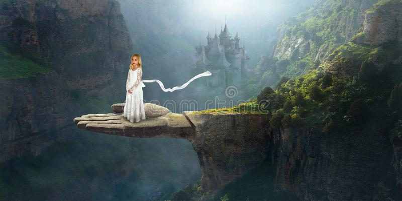 Imagination, Inspiration, Fantasy, Surreal Girl. A young girl stands on a cliff ledge in a surreal fantasy landscape. Imagination and inspiration abstract stock photography