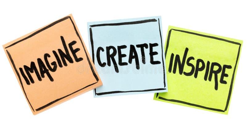 Imagine, crie, inspire o conceito em notas pegajosas fotos de stock