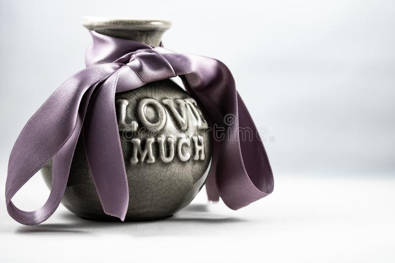 Imagine of a vase for a loved one. An imagine of a vase with purple ribbon for a loved one stock photography