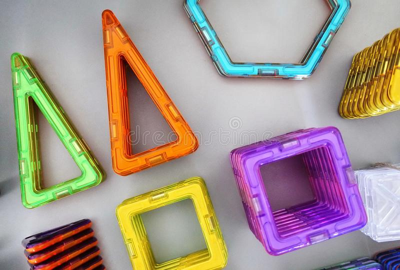 Bright geometric shapes on a magnetic base. Of these figures, the designer can assemble the various models. Perfect for the develo royalty free stock image