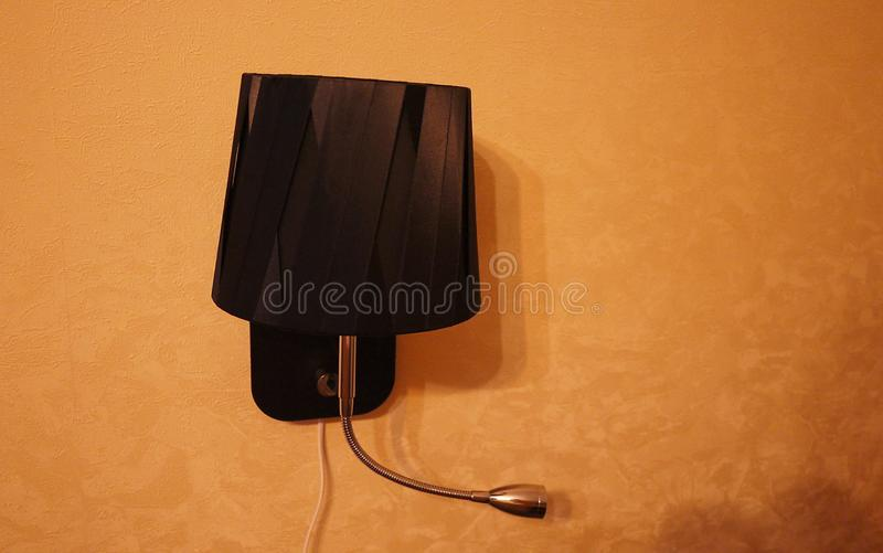 Wall sconce for apartment or hotel. Mounted on the wall. Details and close-up. Wall sconce for apartment or hotel. Mounted on the wall. Details close-up royalty free stock image