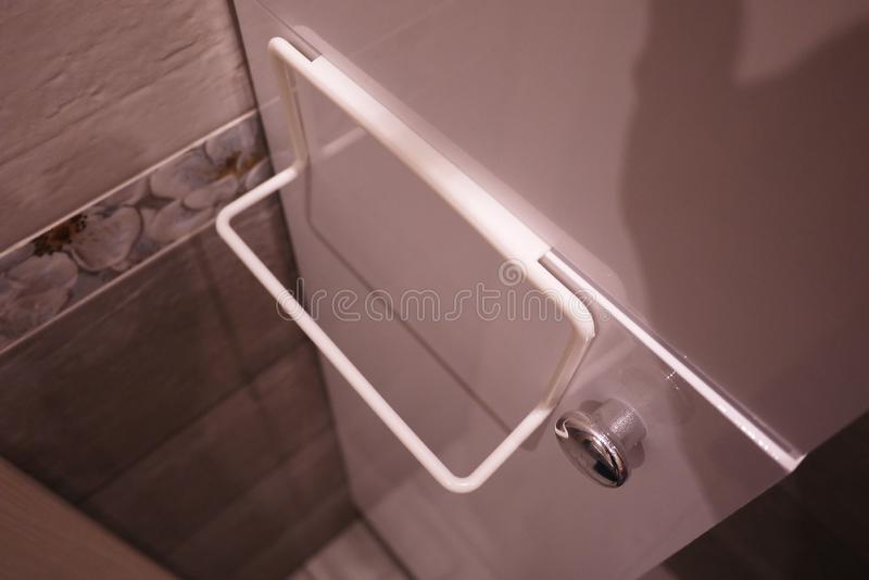 Towel rack to bathroom or kitchen. Small accessory interior bathroom or kitchen, will help in the economy. Details and closging. Towel rack to bathroom or stock images
