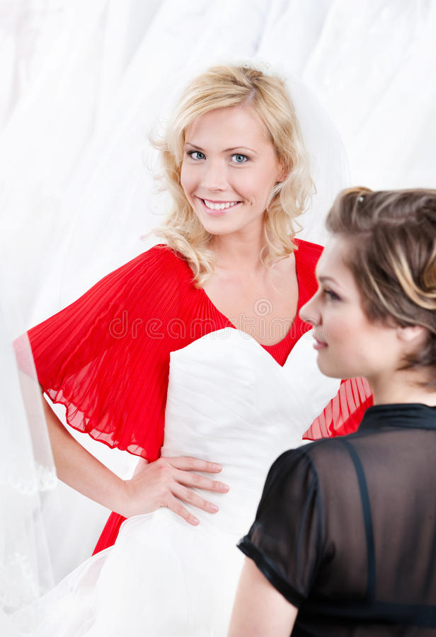 Imagining herself in wedding gown royalty free stock photography