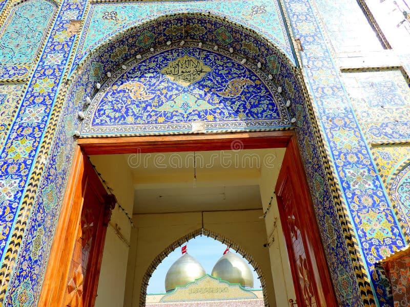 Entrance gate of Holy Shrine of Husayn Ibn Ali, Karbala, Iraq. The Imam Husain Shrine or the Station of Imam Husayn Ibn Ali is the mosque and burial site of stock images