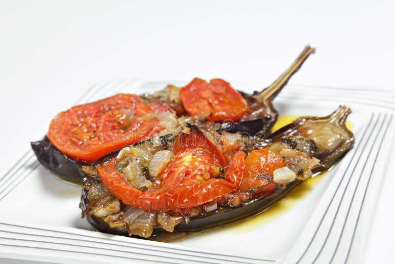 Imam melitzanes. Imam balidi or Imam melitzanes, a delicious Greek or Turkish vegetarian dish of eggplant (aubergine) stuffed with onion, garlic, parsley and royalty free stock image