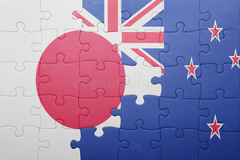 Imbarazzi con la bandiera nazionale del Giappone e della Nuova Zelanda immagine stock libera da diritti