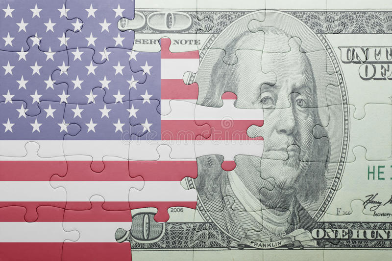 Imbarazzi con la bandiera nazionale della banconota del dollaro e degli Stati Uniti d'America immagini stock