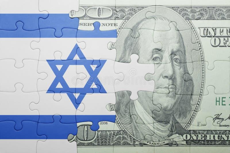 Imbarazzi con la bandiera nazionale della banconota del dollaro e dell'Israele fotografia stock libera da diritti