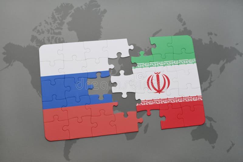 imbarazzi con la bandiera nazionale della Russia e dell'Iran su un fondo della mappa di mondo illustrazione di stock