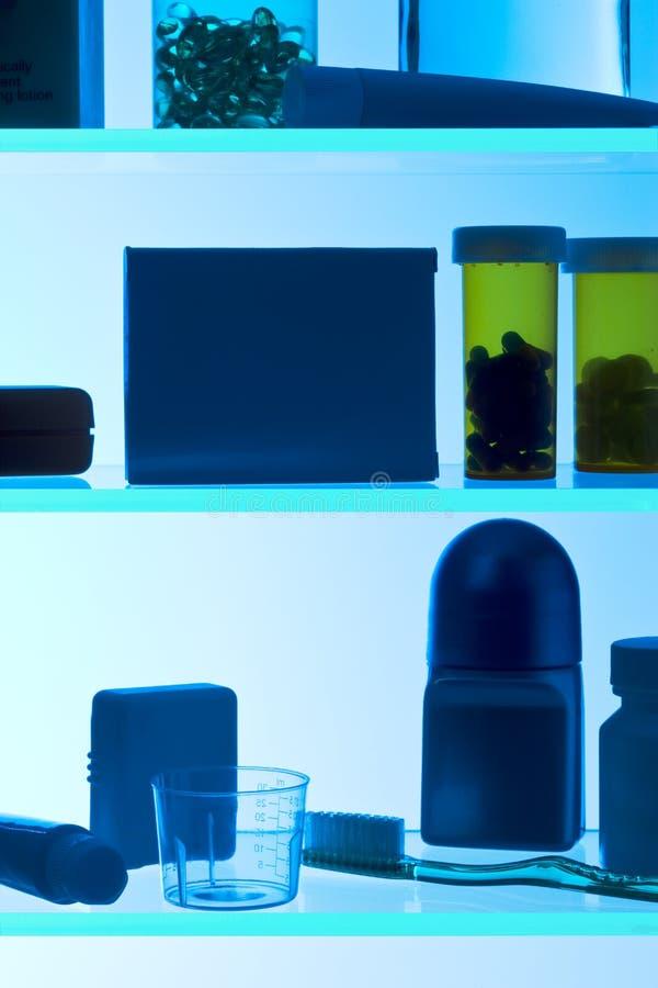 imbottigli le pillole della medicina dell'armadietto fotografia stock