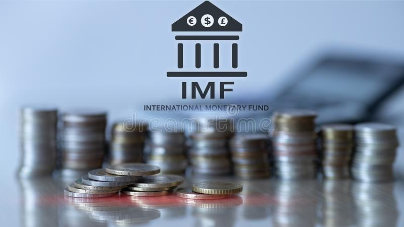 IMF. International Monetary Fund. Finance and banking concept. Coins background.  royalty free stock images