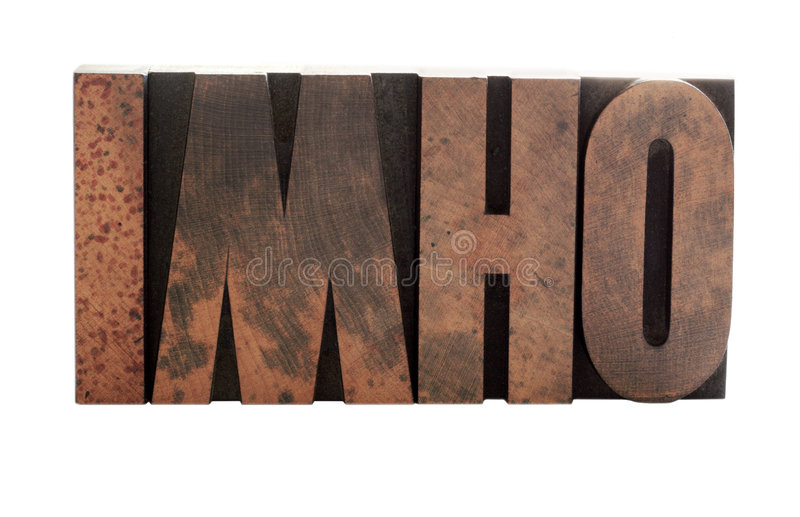 Imho in old wood letters. The term 'imho' in old, ink-stained wood letters royalty free stock image