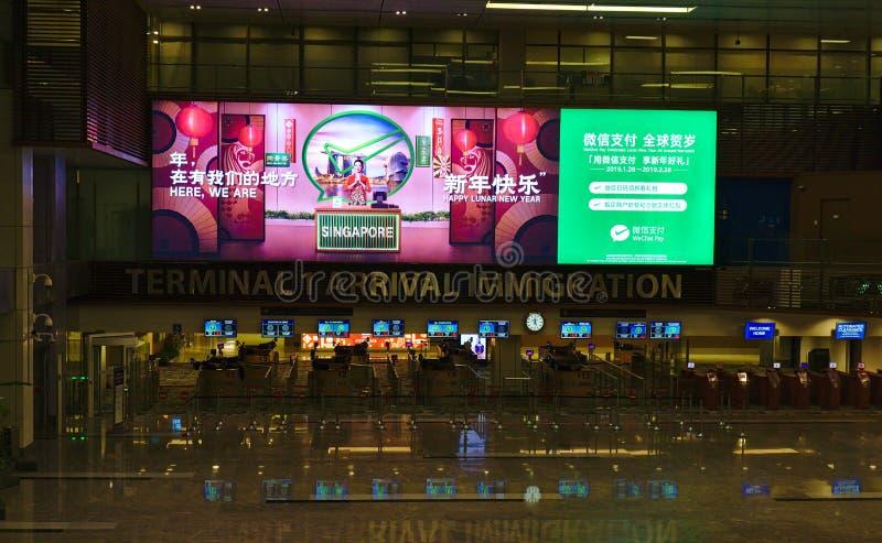 Imigração da chegada do terminal 1 no aeroporto imagem de stock