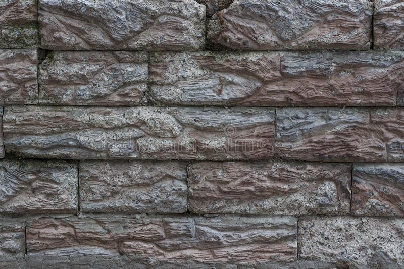 Old wall. Imitation of brick masonry from artificial stone. stock photo