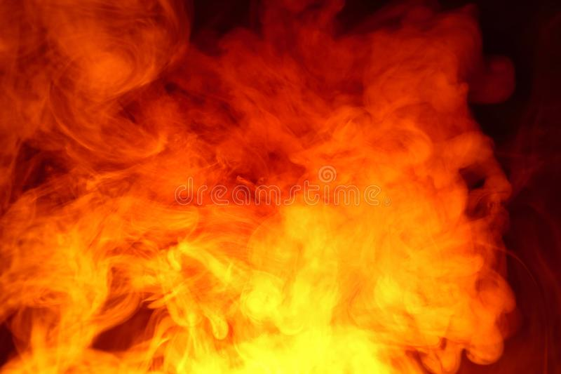Imitation of bright flashes of orange-red flame. Background of abstract colored smoke. Imitation of bright flashes of orange-red flame. Background from abstract royalty free stock photos
