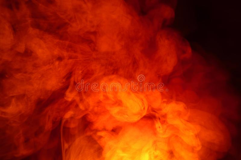 Imitation of bright flashes of orange-red flame. Background of abstract colored smoke. Imitation of bright flashes of orange-red flame. Background from abstract stock image